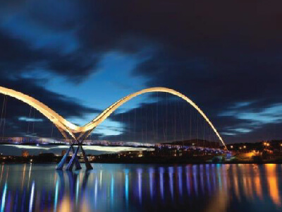 Photograph for News - Stockton on Tees Infinity Bridge at night with reflections on water